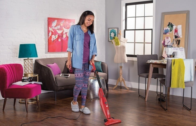 Woman Vacuuming Living Room