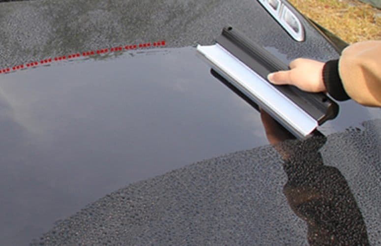 using rubber broom for car