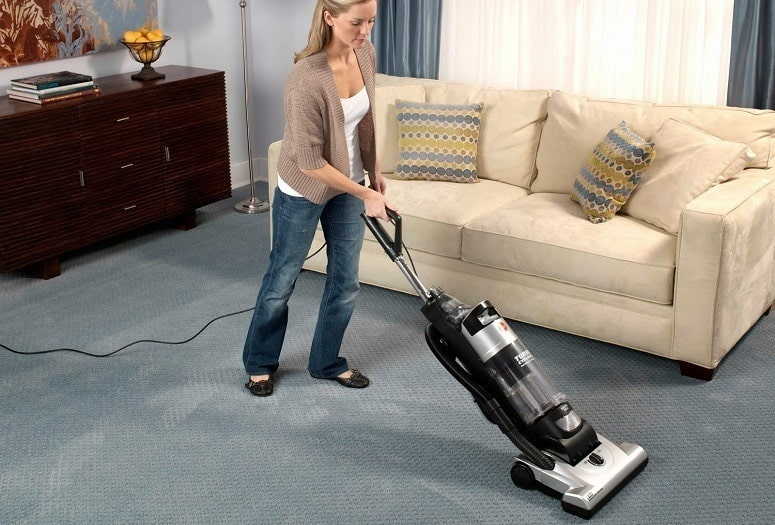 vacuuming the bedroom